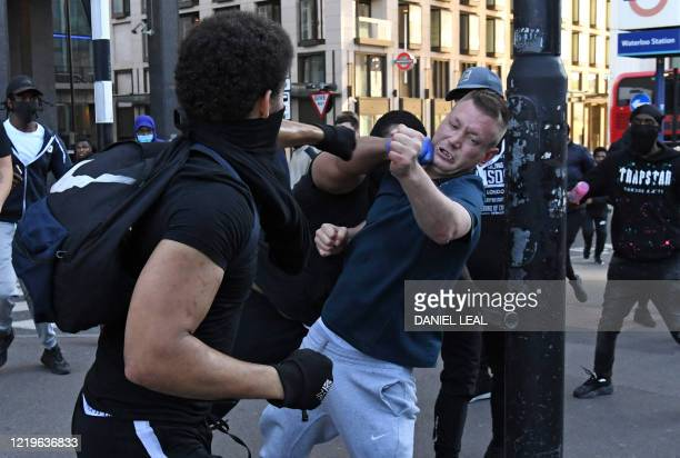 Fight takes place near Waterloo Station as protesters supporting the Black Lives Matter movement clash with opponents in central London on June 13 in...