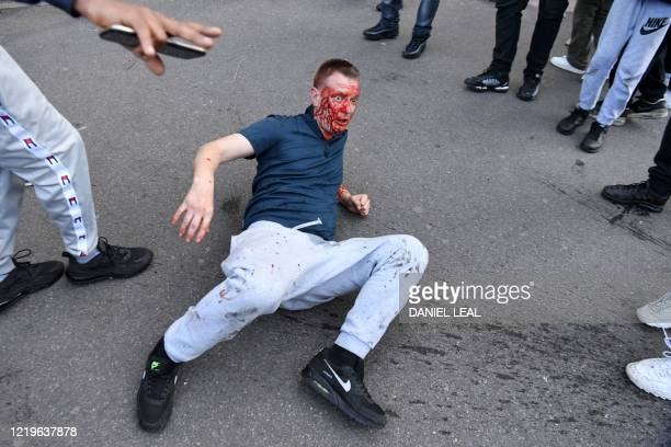 A fight takes place near Waterloo Station as protesters supporting the Black Lives Matter movement clash with opponents in central London on June 13...