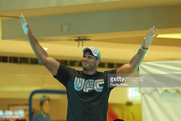 UFC fighter Alistair Overeem gestures to the crowd as he arrives at the SM Megamall event center on Sunday April 19 2015 Overeem is making his first...