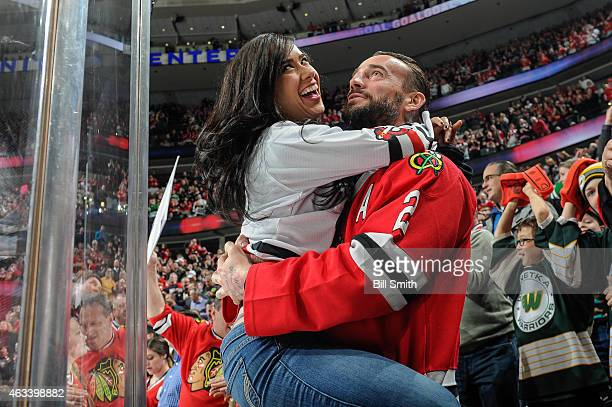 MMA fighter and former WWE champion CM Punk and wife WWE wrestler AJ Lee celebrate after the Chicago Blackhawks scored against the New Jersey Devils...
