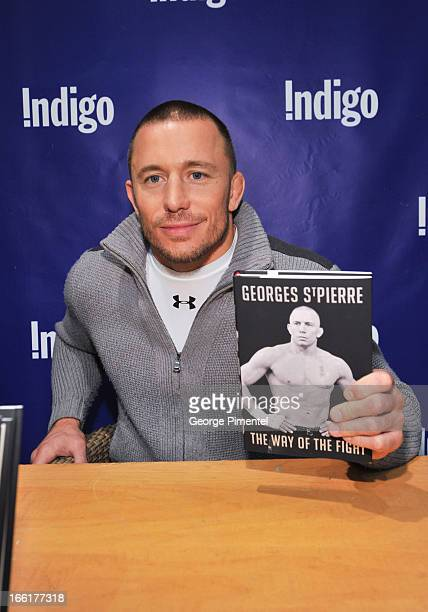 UFC fighter and welterweight champion Georges StPierre signs copies of his book GSP The Way Of The Fight at Indigo on April 9 2013 in Toronto Canada