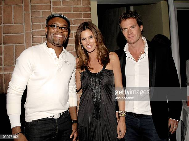 UFC fighter Anderson Silva model Cindy Crawford and husband Rande Gerber pose at the UFC 104 PreParty hosted By Dana White Lorenzo Fertita and Frank...