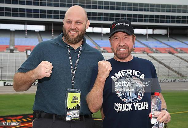 UFC fighter Ben Rothwell poses with actor Chuck Norris prior to the NASCAR Sprint Cup Series AAA Texas 500 at Texas Motor Speedway on November 6 2016...