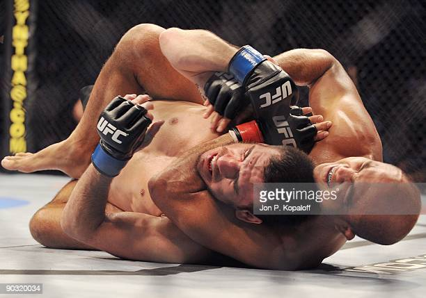 UFC fighter BJ Penn chokes out UFC fighter Kenny Florian during their Lightweight Championship fight at UFC 101 Declaration at the Wachovia Center on...