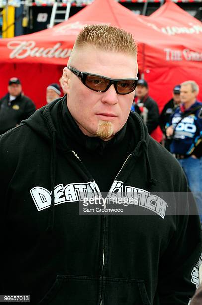 MMA fighter Brock Lesnar walks in the garage area during practice for the Daytona 500 at Daytona International Speedway on February 13 2010 in...