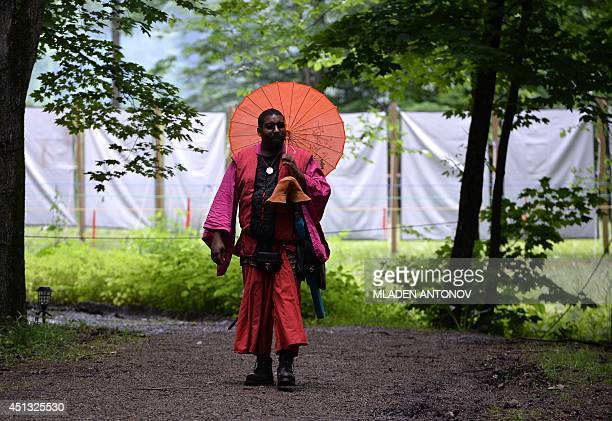 A fighter carries his combat gear prior to the beginning of a battle at the XXIX Dagorhir Ragnarok battle game event at a field near the town of...