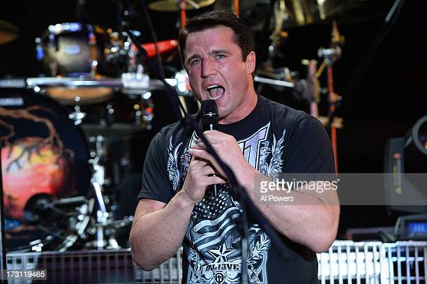 UFC fighter Chael Sonnen introduces musical act Three Days Grace during the UFC Fight Week festivities at the Fremont Street Experience on July 4...
