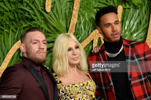 Fighter Conor McGregor designer Donatella Versace and F1 driver Lewis Hamilton attend The Fashion Awards 2017 in partnership with Swarovski at Royal...