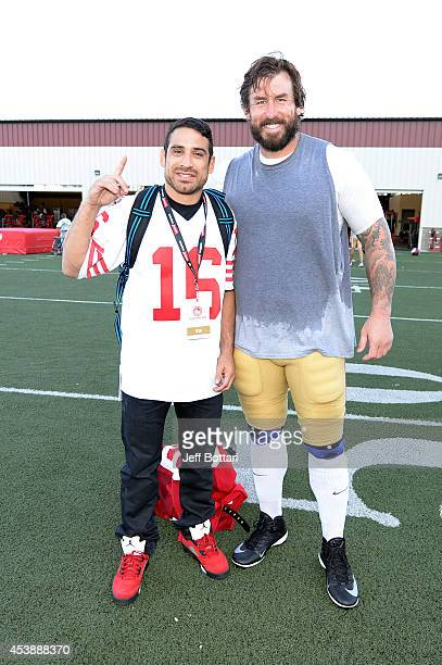 UFC fighter Danny Castillo poses with San Francisco 49ers offensive tackle Adam Snyder at the SAP Performance Facility at Levi's Stadium on August 20...