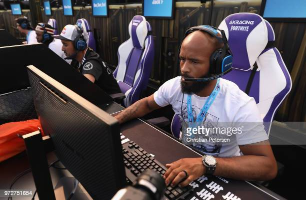 Fighter Demetrious Johnson competes in the Epic Games Fortnite E3 Tournament at the Banc of California Stadium on June 12 2018 in Los Angeles...