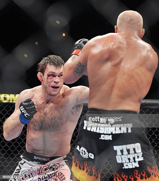 Fighter Forrest Griffin battles Tito Ortiz during their Light Heavyweight Fight at UFC 106: Ortiz vs. Griffin 2 at Mandalay Bay Events Center on...