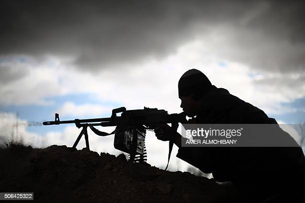 Fighter from Jaish al-Islam , the foremost rebel group in Damascus province who fiercely oppose to both the regime and the Islamic State group, holds...