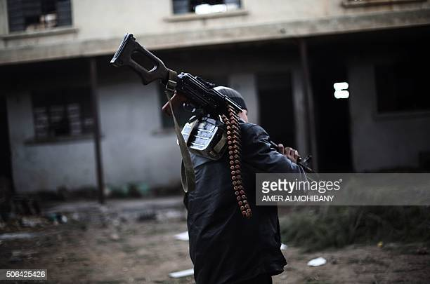 A fighter from Jaish alIslam the foremost rebel group in Damascus province who fiercely oppose to both the regime and the Islamic State group walks...