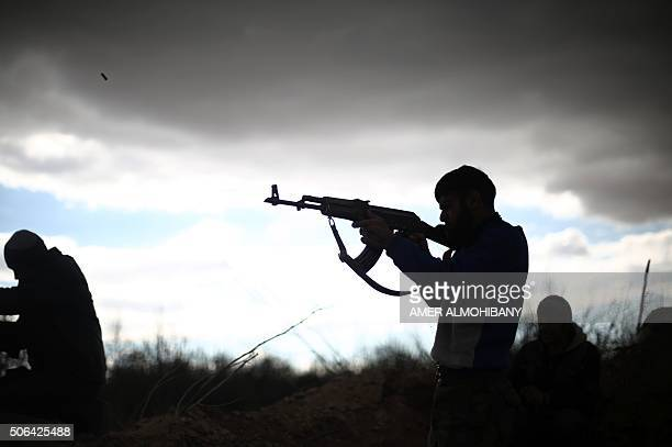 A fighter from Jaish alIslam the foremost rebel group in Damascus province who fiercely oppose to both the regime and the Islamic State group fires...
