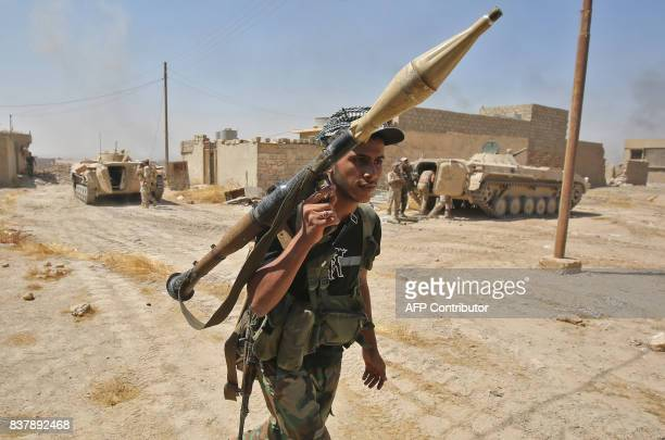 TOPSHOT A fighter from the Hashed AlShaabi carries his RPG inside alNour neighbourhood in eastern Tal Afar the main remaining stronghold of the...