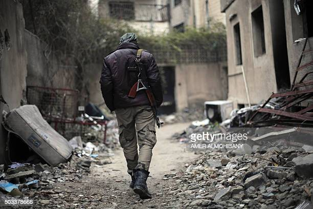 A fighter from the Jaish alIslam the foremost rebel group in Damascus province who fiercely opposed to both the regime and the Islamic State group...
