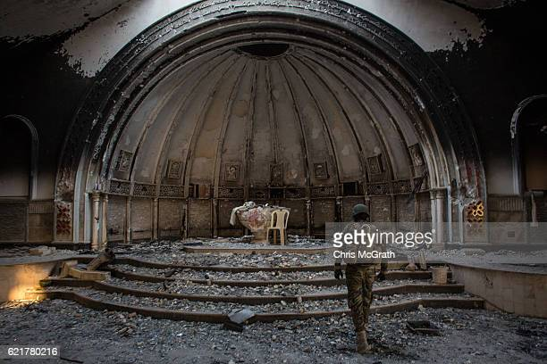Fighter from the NPU waks through a destroyed church on November 8, 2016 in Qaraqosh, Iraq. The NPU is a military organization made up of Assyrian...