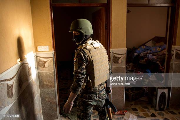 A fighter from the NPU walks through a house used by ISIL on November 8 2016 in Qaraqosh Iraq The NPU is a military organization made up of Assyrian...