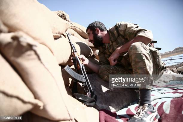 TOPSHOT A fighter from the Nureddine alZinki unit a moderate Syrian opposition faction affiliated with the Muslim Brotherhood and made up of former...