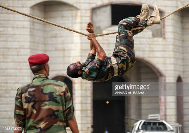 A fighter from the Popular Resistance Committees supporting forces loyal to Yemen's Saudibacked President Abedrabbo Mansour Hadi performs manoeuvres...