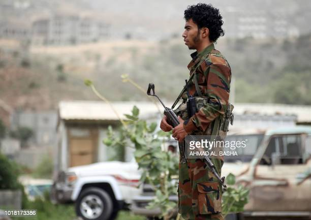A fighter from the Popular Resistance Committees supporting forces loyal to Yemen's Saudibacked President Abedrabbo Mansour Hadi stands guard during...