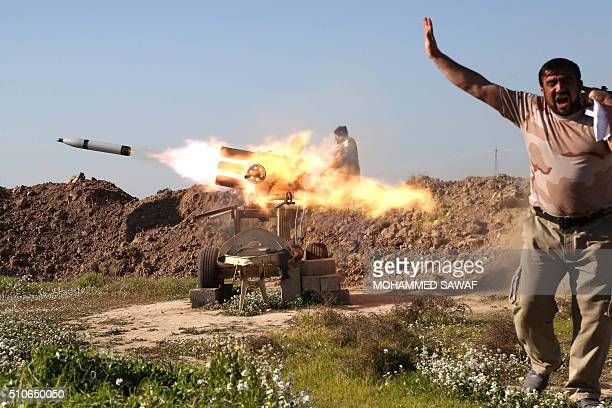 TOPSHOT A fighter from the progovernment Popular Mobilisation units covers his ears as he sets off a rocket launcher in the village of Taz Khurmatu...
