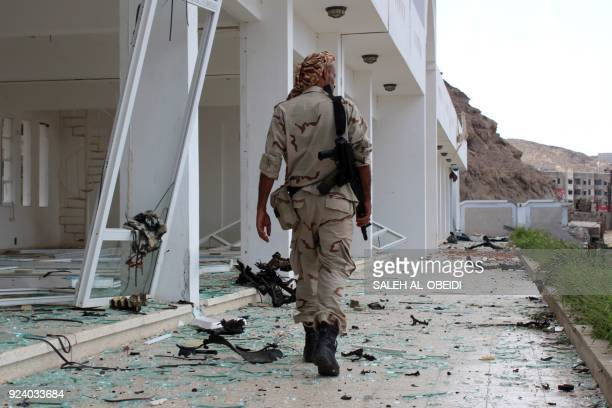 A fighter from the separatist Southern Transitional Council gather on February 25 at the site of two suicide car bombings that targeted the...