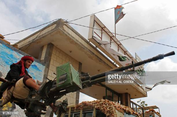TOPSHOT A fighter from the separatist Southern Transitional Council sits on the back of an armed vehicle after they took control of a progovernment...