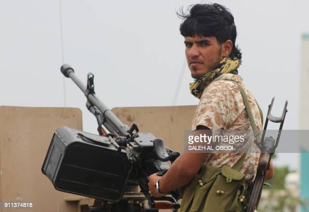 A fighter from Yemen's southern separatist movement holds a position in a street of the country's second city of Aden on January 28 during clashes...