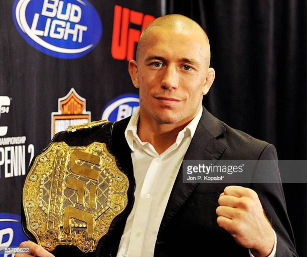 UFC fighter George StPierre poses with his UFC belt at the UFC 94 StPierre v Penn 2 Press Conference at the MGM Grand Arena on November 15 2008 in...