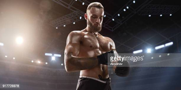 MMA fighter in professional boxing ring