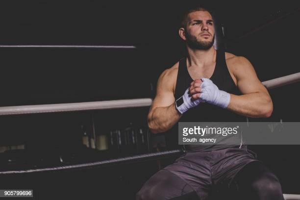 fighter in the boxing ring - mma stock pictures, royalty-free photos & images
