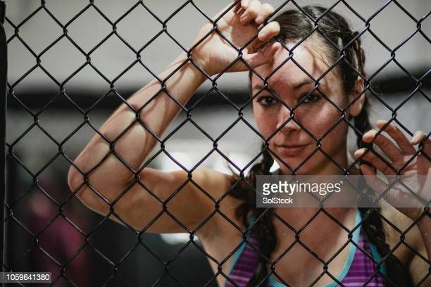 fighter in the cage - exploitation stock pictures, royalty-free photos & images