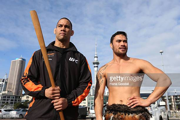 UFC fighter James Te Huna accepts the taiaha from Edz Eramiha after a traditional maori welcome at Te Wero Bridge on June 24 2014 in Auckland New...