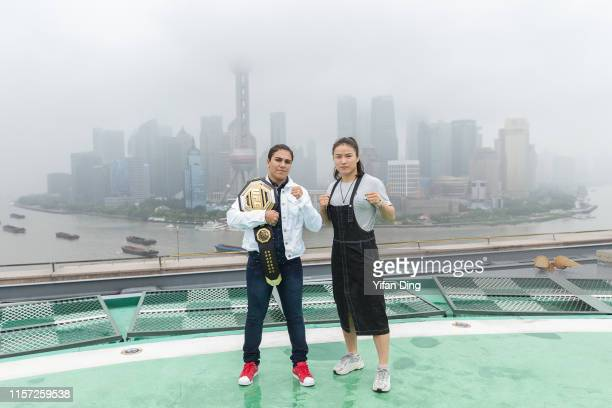 UFC fighter Jessica Andrade and UFC fighter Zhang Weili pose for photo during UFC Iconic photo session at The Peninsula Shanghai on June 21 2019 in...
