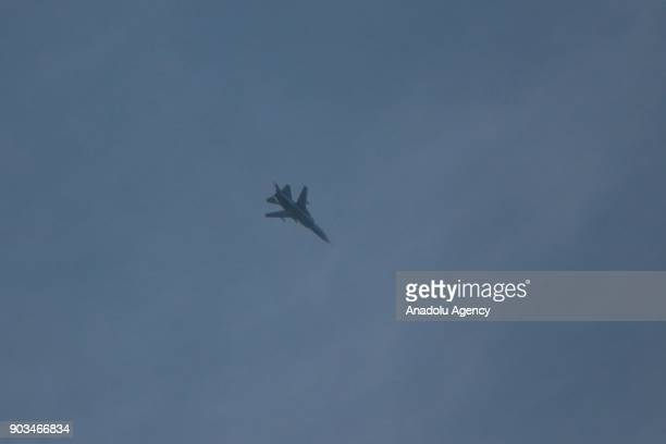 A fighter jet of Assad regime is seen over the deescalation zone of Arbin town of besieged Eastern Ghouta in Damascus Syria on January 10 2018