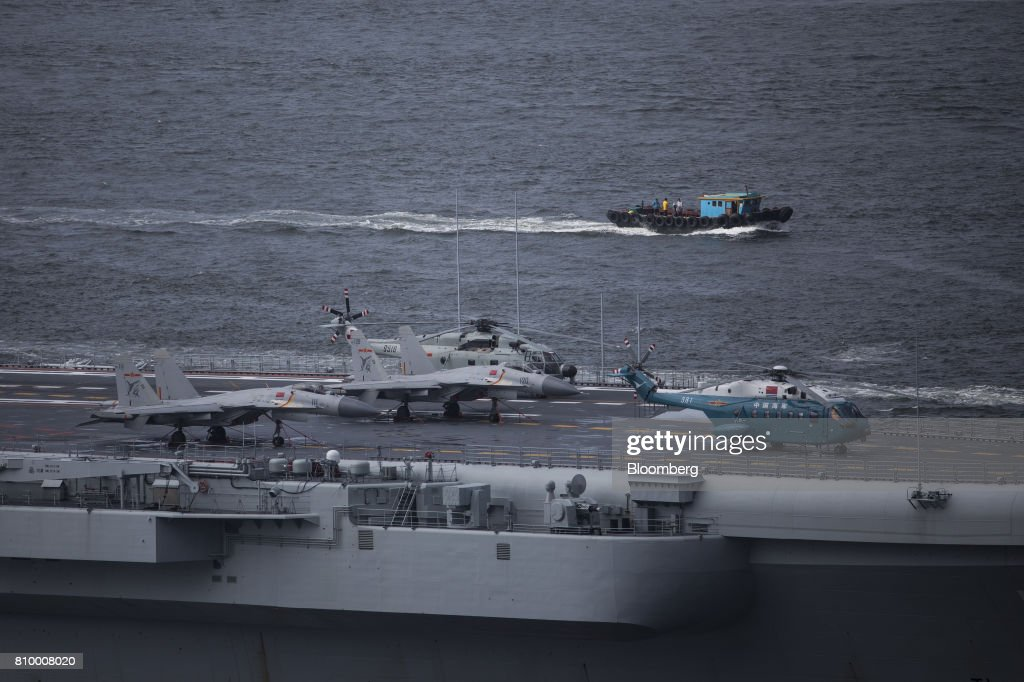 Fighter jets and helicopters stand onboard the People's Liberation Army (PLA) Liaoning aircraft carrier as it sails into Hong Kong, China, on Friday, July 7, 2017. The carrier will visit Hong Kong between July 7 and 11. Photographer: Justin Chin/Bloomberg via Getty Images