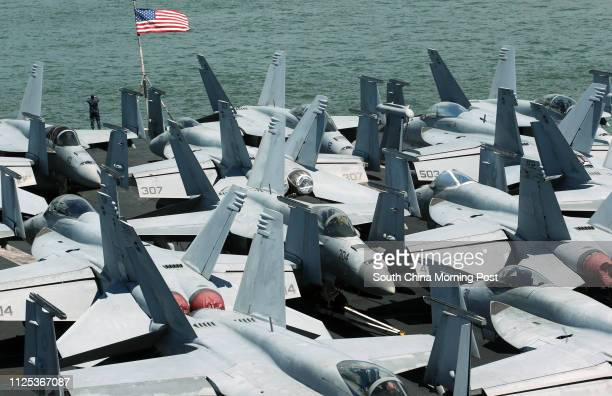 Fighter jets are seen on the deck of US carrier USS George Washington as it stations off Hong Kong waters during a routine port visit to the...