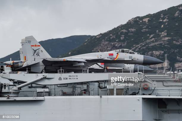 Fighter jets are seen on the flight deck of China's sole aircraft carrier, the Liaoning, as it arrives in Hong Kong waters on July 7 less than a week...