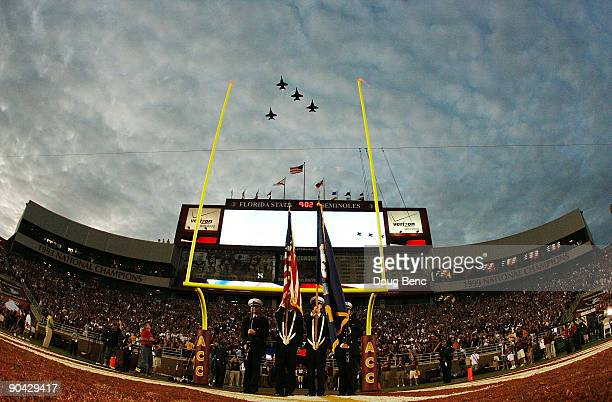 FA18 fighter jets do a missing man flyover to honor FSU graduate and US Navy pilot Scott Speicher who was shot down in the first Gulf War during...