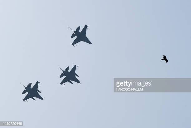 F16 fighter jets flyduring the rehearsal of the Pakistan National Day army parade in Islamabad on March 15 2019 Pakistan will celebrate its National...