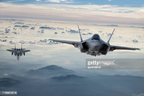 fighter jets flying at twilight - aerospace industry stock pictures, royalty-free photos & images