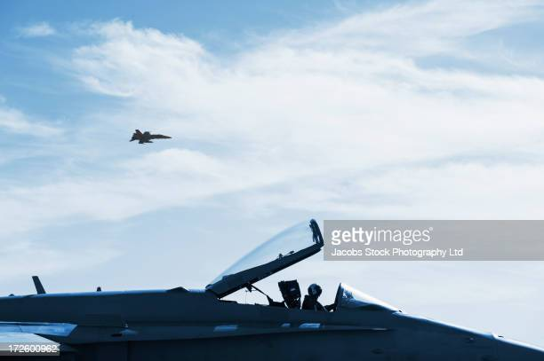 Fighter jets flying in sky