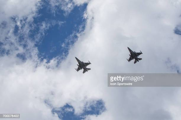 F16 fighter jets flyover the track prior to the start of the the Monster Energy Cup Series Firekeepers Casino 400 race on June 18 2017 at Michigan...