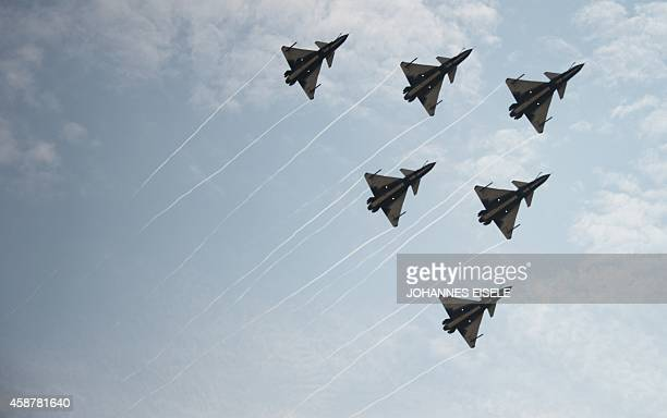 J10 fighter jets of the Bayi Aerobatic Team of PLA's Air Force perform during a flight at the Airshow China 2014 in Zhuhai south China's Guangdong...