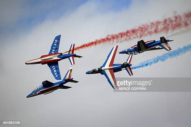 Fighter jets of the The Patrouille de France perform during the first day of AIR14 airshow on August 30 2014 in Payerne western Switzerland The...