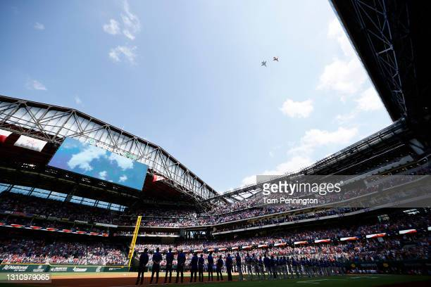 Fighter jets perform a flyover during the National Anthem before the Texas Rangers take on the Toronto Blue Jays on Opening Day at Globe Life Field...