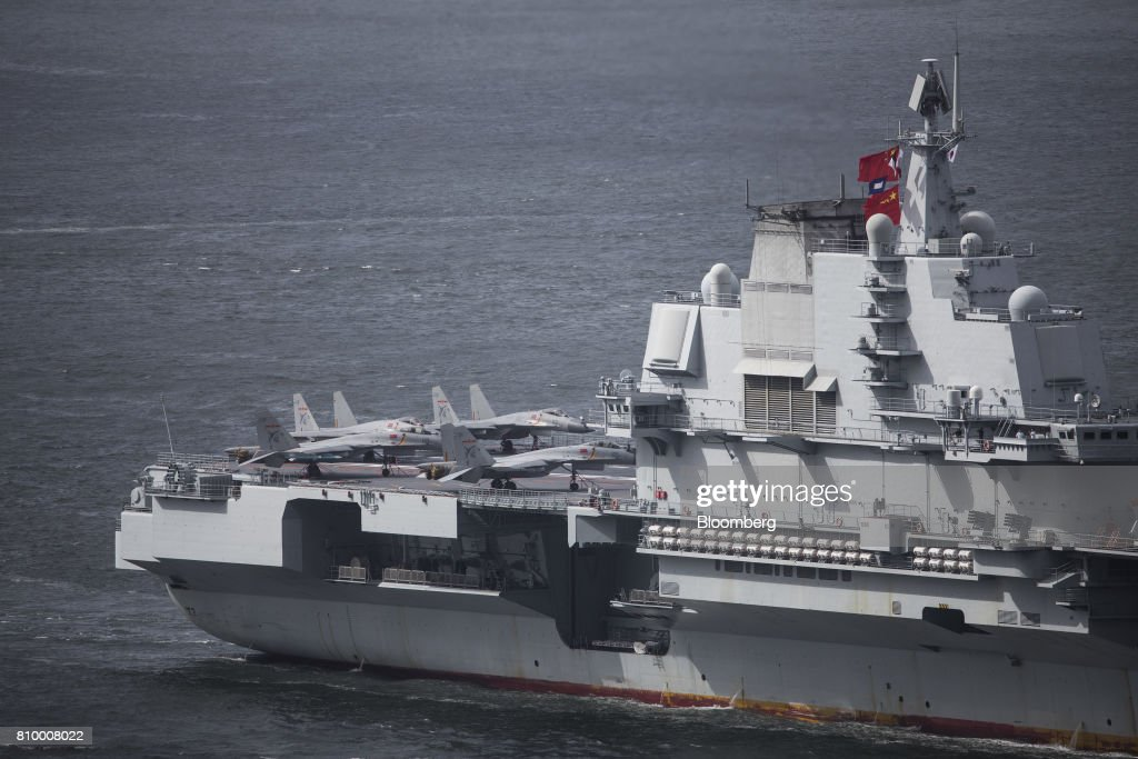 Fighter jets stand onboard the People's Liberation Army (PLA) Liaoning aircraft carrier as it sails into Hong Kong, China, on Friday, July 7, 2017. The carrier will visit Hong Kong between July 7 and 11. Photographer: Justin Chin/Bloomberg via Getty Images