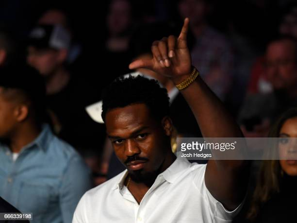 Fighter Jon Jones watches the match between Daniel Cormier and Anthony Johnson in their UFC light heavyweight championship bout during the UFC 210...