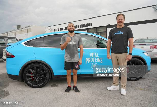 UFC fighter Jorge Masvidal and Vital Performance CEO Kurt Seidensticker are seen during the Vital Performance Tesla Exchange on July 15 2020 in Miami...